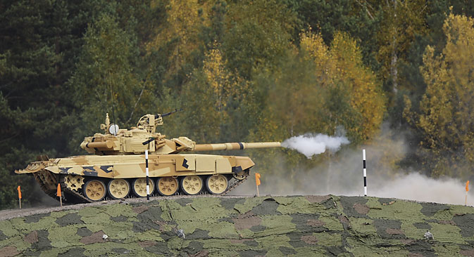 A T-90 tank shoots its cannon during opening of the 10th international exhibition Russia Аrms Еxpo in Nizhny Tagil. Source:  Pavel Lisitsyn / RIA Novosti
