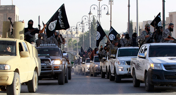 ISIS fighters parade through the Syrian city of Raqqa, considered the capital of the movement. Source: Reuters