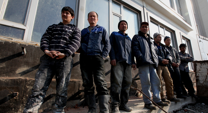 Foreign workers wait as staff members of the Immigration Control Department at Russia's Federal Migration Service Administration for the Primorky Territory conduct a sweep in search of illegal migrants. Source: Vitaliy Ankov / RIA Novosti