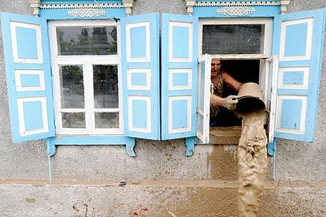 Unas gigantescas inundaciones en la región de Krasnodar dejaron más de 170 víctimas mortales, al menos 650 casas destruidas y 3.300 personas sin propiedades. Fuente: RIA Novosti / Ilia Pitalev.
