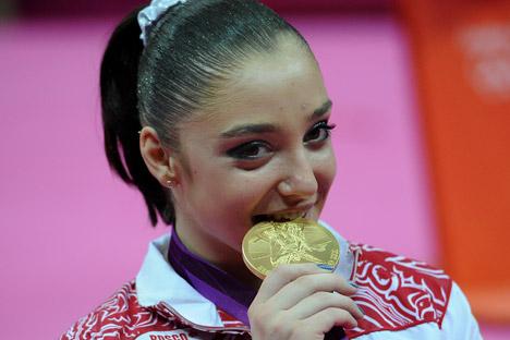 Alia Mustafina oro en barras asimétricas. Fuente: Itar Tass.