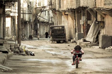 Combates entre as tropas do governo e militantes sírios já deixaram mais de 100.000 mortos Foto: AFP/East News