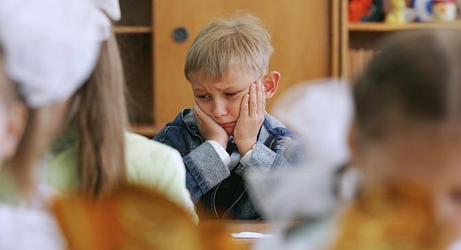 Chaque classe a son bouc émissaire, et les enfants peuvent parfois s'avérer incroyablement cruels et sans pitié avec eux. Crédit : Itar-Tass