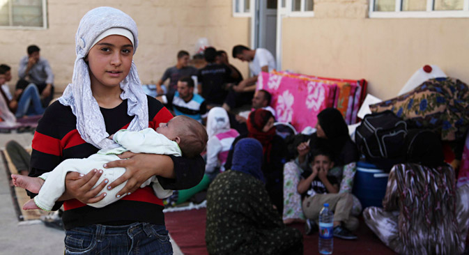 Souvent, ce sont les femmes et les enfants qui ont quitté leur logement et sont devenus réfugiés, alors que les hommes restent pour défendre les lieux qui les ont vu naître ou pour combattre. Crédit : Reuters