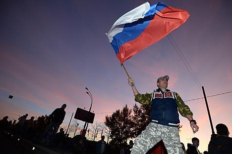 Le nombre de Russes ayant défini le concept de patriotisme comme « l'amour de la patrie » se maintient sous le seuil des 60 %. Crédit : Ramil Sitdikov / RIA Novosti