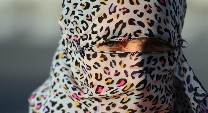 A cause du hijab, il est possible de perdre non seulement son travail, mais même de finir au poste. Crédit : Ramil Sitdikov / RIA Novosti