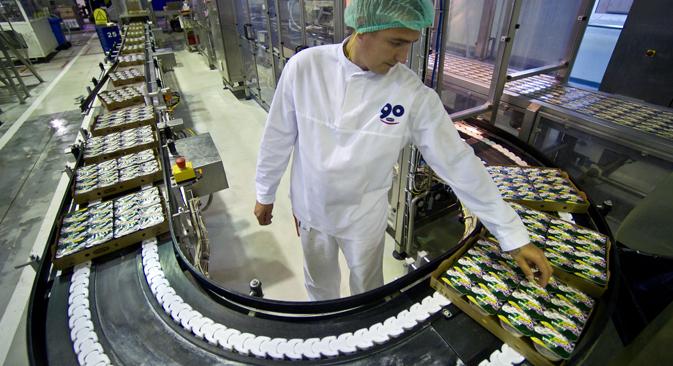 Jusqu'ici, Danone se contentait d'acheter son lait à des producteurs locaux. Crédit : Itar-Tass