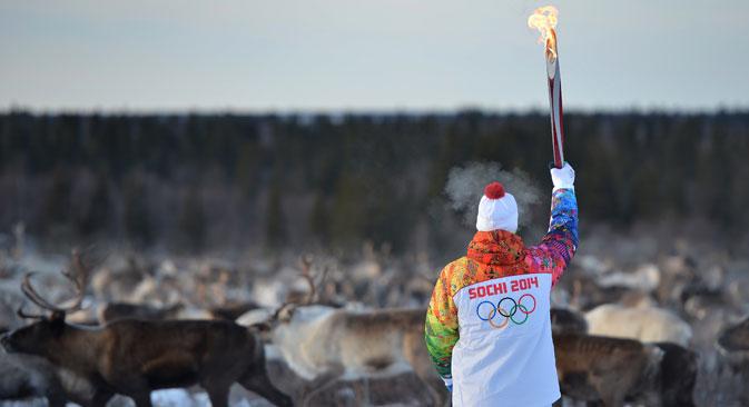 Pour travailler auprès des porteurs de torches olympiques, la rémunération prévue était de 1 500 à 2000$. Crédit : Ramil Sitdikov / RIA Novosti