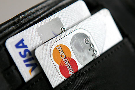 A concessão aos sistemas de pagamento estrangeiros se deve ao fato que o Estado não tem interesse na saída deles do mercado russo Foto: DPA / Vostok Photo