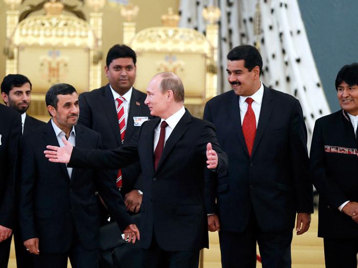 Bolivian President Evo Morales, Venezuelan President Nicolas Maduro, Russia's President Vladimir Putin, Iranian President Mahmoud Ahmadinejad, Iraqi Prime Minister Nouri al-Maliki and other officials at the GECF in Moscow. Source: Reuters
