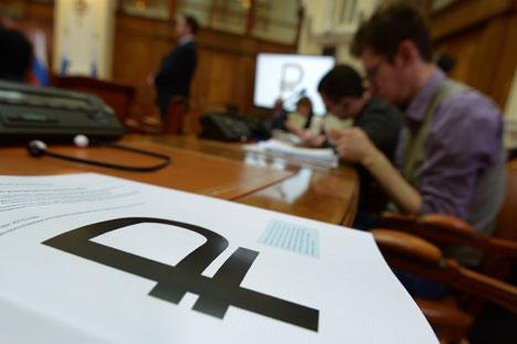 Tahun ini rubel Rusia mendapat simbol resmi. Sumber: RIA Novosti