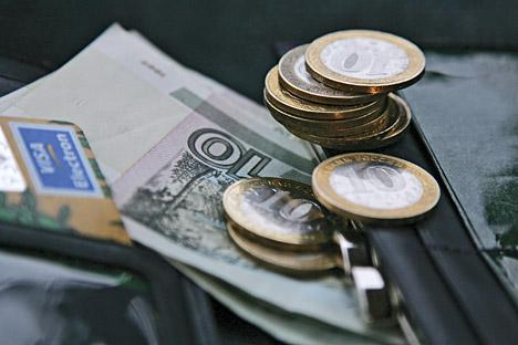 Para ahli memperkirakan, pada akhir 2014 nilai tukar rubel terhadap dolar AS bisa mencapai 37,50-38 rubel. Sumber: ITAR-TASS