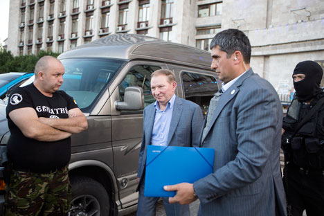 Mantan Presiden Ukraina Leonid Kuchma (tengah) mewakili Ukraina dalam negosiasi untuk mencari solusi konflik Ukraina yang dilaksanakan di Minsk minggu lalu. Foto: Reuters