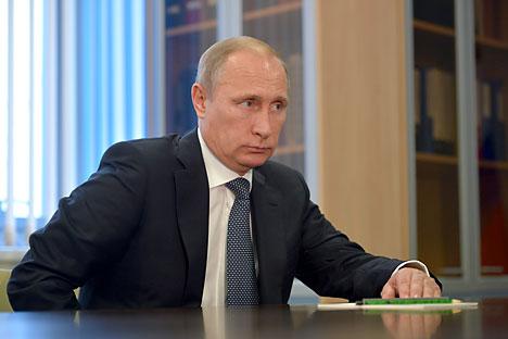 Vladimir Putin: Semua pihak harus sadar bahwa ekonomi dan keuangan dunia saat ini sangat bergantung satu sama lain. Foto: Alexey Druzhinin/TASS