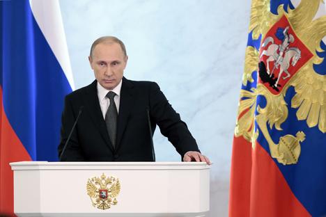 Presiden Rusia Vladimir Putin menyampaikan pidato tahunan di hadapan Dewan Federasi pada Kamis (4/12), di Moskow, Rusia. Foto: Mikhail Metsel/TASS