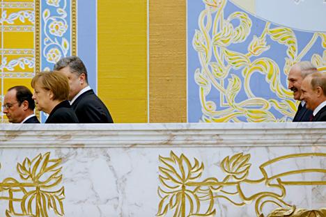 Perundingan berjam-jam antara Putin, Merkel, Hollande, dan Poroshenko di Minsk terkait penyelesaian krisis Ukraina itu telah berakhir. Kredit: AP