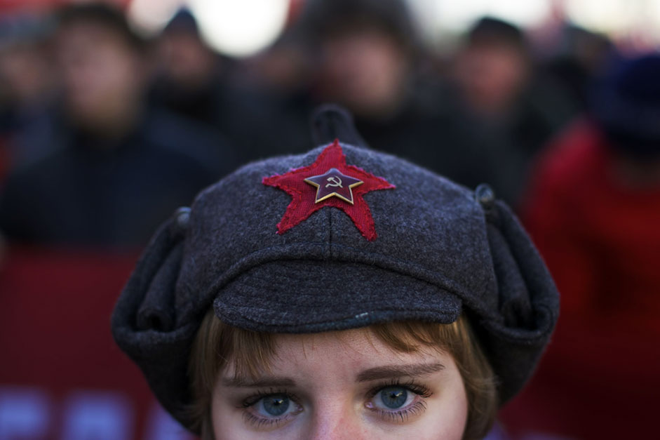 A girl wears a hat with a Soviet-era insignia as she takes part in aCommunist demonstration marking the 98th anniversary of the Bolshevikrevolution in Moscow, Russia, Saturday, Nov. 7, 2015. For decades Nov.7 used to be a holiday celebrating the 1917 Bolshevik Revolution andwhich is no longer a public holiday in Russia.