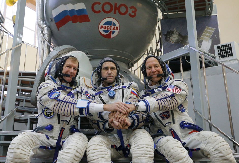 Members of the International Space Station expedition 46/47: (L-R) British ESA astronaut Timothy Peake, Russian cosmonaut Yuri Malenchenko and US NASA astronaut Timothy Kopra pose for the media in front of Soyuz space craft simulator prior to pass final exams in the Russian cosmonaut training center in Star City outside Moscow, Russia. Launch of the mission is scheduled on 15 December from cosmodrome Baikonur (Kazakhstan).