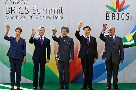 Brazil's president Dilma Rousseff, Russian President Dimitry Medvedev, Indian Prime Minister Manmohan Singh, Chinese President Hu Jintao and South African President Jacob Zuma pose during the 4th BRICS summit held in New Delhi, India, on Thrusday, Ma