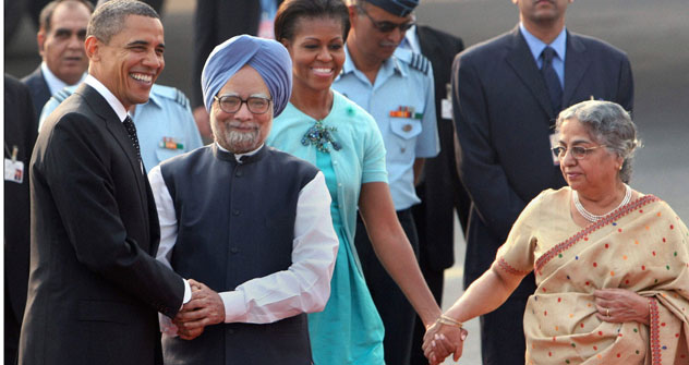 U.S. President Barack Obama, left, is greeted by Indian Prime Minister Manmohan Singh, second left, as first lady Michelle Obama is received by Singh's wife Gursharan Kaur, right, in New Delhi, India, Sunday, Nov.7, 2010. Source: AP