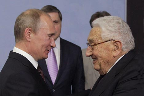 President Vladimir Putin and former United States secretary of state Henry Kissinger. Credit: Reuters.