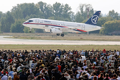 Visitors watch a Sukhoi Superjet 100 during the MAKS-2009 international air show in Zhukovsky outside Moscow. Source: Reuters / Vostock Photo