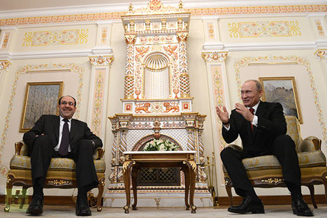 Wakil Presiden Irak Nuri al-Maliki (kiri) dan Presiden Rusia Vladimir Putin.