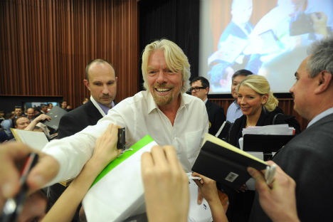 "English businessman, Virgin Group chairman, Sir Richard Branson (C) signing autographs after ""Future Money"" conference at the Skolkovo School of Management. Source: ITAR-TASS"