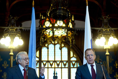 Russian Foreign Minister Sergey Lavrov, right, and envoy Lakhdar Brahimi face reporters after talks Monday in Moscow. Source: AFP/ East News