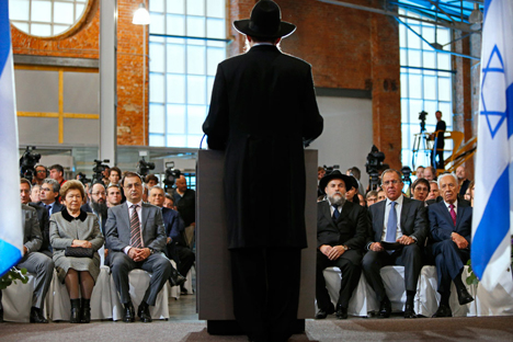 Chief rabbi of Russia Berel Lazar, center, delivers a speech an opening ceremony of Russia's first Jewish Museum in Moscow. Source: AP