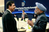 Pakistani Prime Minister Yousuf Raza Gilani, left, talks with the Prime Minister of India Manmohan Singh at the Nuclear Summit in Seoul, South Korea, March, 27, 2012.
