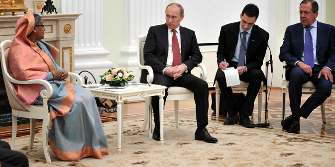 Russia's President Vladimir Putin speaks with Bangladesh's Prime Minister Sheikh Hasina (left) during their meeting in Moscow, Jan 15, 2013, with Russian Foreign Minister Sergei Lavrov (right) attending. Source: AFP/East News