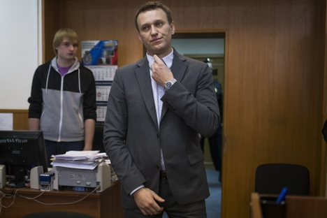 Russian opposition activist Alexei Navalny, center, listens to a judge inside a courtroom in Moscow on March 13, 2013, after his appeal against the country's top investigative agency was rejected. Source: AP