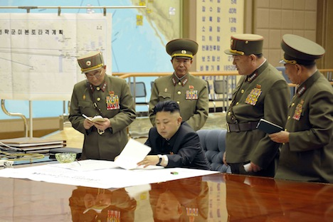 North Korean leader Kim Jong Un, center, discussing strategic plans with military personnel. Source: Reuters