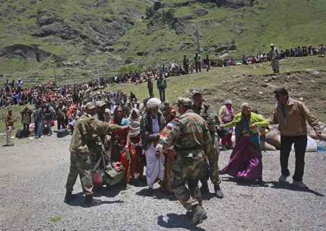 Soldiers stop survivors from going near an army helicopter as its lands during rescue operations at Badrinath in the Himalayan state of Uttarakhand June 21, 2013. Source: Reuters/Danish Siddiqu