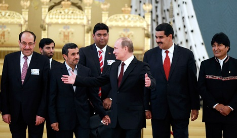 Bolivian President Evo Morales, Venezuelan President Nicolas Maduro, Russia's President Vladimir Putin, Iranian President Mahmoud Ahmadinejad, Iraqi Prime Minister Nouri al-Maliki and other officials at the GECF in Moscow. Source: Reuters