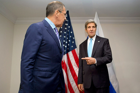 U.S. Secretary of State John Kerry gestures toward Russian Foreign Minister Sergey Lavrov (L), as he deflects a question from a reporter about whether they will discuss asylum for NSA leaker Edward Snowden, at the ASEAN summit in Brunei. Source: AP