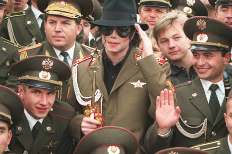 American popstar Michael Jackson makes a mock military salute, as he is surrounded by Russian army musicians on Moscow's World War II memorial. Source: AP