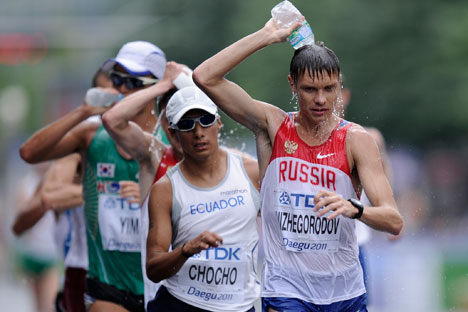 From right, Russia's Denis Nizhegorodov, Ecuador's Andres Chocho and South Korea's Yim Junghyun compete during the Men's 50km Race Walk at the World Athletics Championships in Daegu, South Korea, 2011. Source: AP
