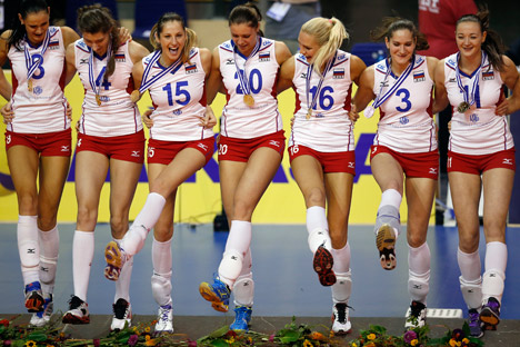 The players of the winning team of Russia dance during the victory ceremony for the Women's Volleyball European Championships in Berlin, Germany, Saturday, Sept. 14, 2013. Source: AP