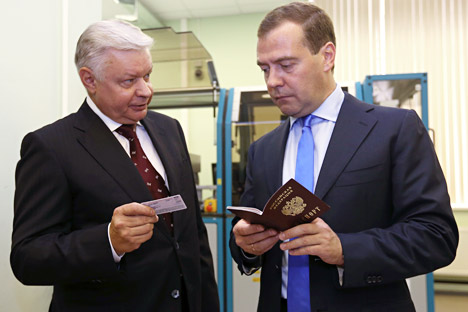 Konstantin Romodanovsky (L), head of the Federal Migration Service, presented new plastic ID documents to Prime Minister Dmitry Medvedev. Source: Itar-Tass
