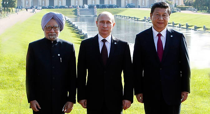 Prime Minister of India Manmohan Singh, President of Russia Vladimir Putin and President of the People's Republic of China Xi Jinping at the G20 summit in St Petersburg.  Source: Reuters