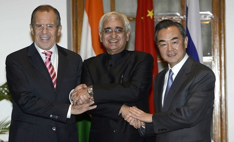 The rise of India and China will shape the world order post-Crimea. Russia's close relationship with these two countries will help it in the crisis. Source: AP