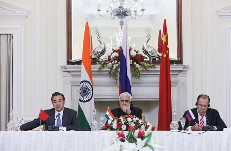 Chinese Foreign Minister Wang Yi, Indian External Affairs Minister Salman Khurshid (C) and Russian Foreign Minister Sergei Lavrov (R) attend a press conference after their meeting in New Delhi, November 10, 2013. Source: Photoshot