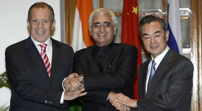 Chinese Foreign Minister Wang Yi (R), Indian External Affairs Minister Salman Khurshid (C) and Russian Foreign Minister Sergei Lavrov (L) at the meeting in New Delhi. Source: AP