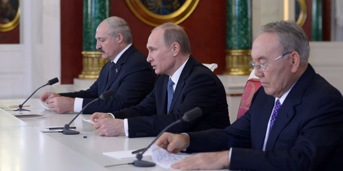 Presidents Vladimir Putin (center) of Russia , Alexander Lukashenko (left) of Belarus and Nursultan Nazarbayev (right) of Kazakhstan making a statement for the press after the end of the Supreme Eurasian Economic Council meeting in the Kremlin on December 24, 2013. Source: Itar-Tass