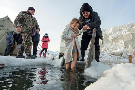 Russians all over the country was diving into the frozen water on Jan. 19. Source: AP