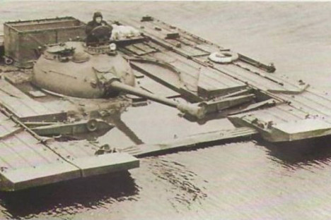 The weight of the PST-U was about 10 tonnes and its movement on water was carried out by a power transfer of the leading tank wheels to two propellers. Source: Press Photo