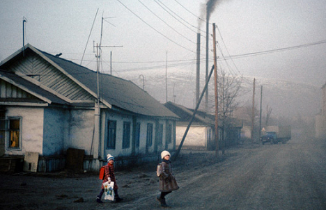 Children dressed in warm winter clothing crossing the road in Magadan. Source: Barry Lewis, Alamy