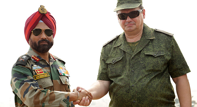 Russia's Lt. General, Alexy Zovizion (R), Chief of Staff (CoS) of the 36th Army and Indian's Army 10 Corps Commander Lt Gen, NS Ghei , shake hands after the INDRA 2013 joint Indo-Russia joint military drill at the Mahajan Field Firing Range in Rajasthan. Source: AFP PHOTO/ Sam PANTHAKY